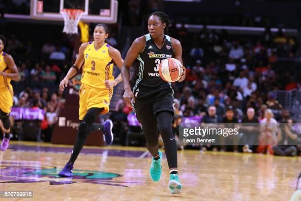 Tina Charles of the New York Liberty handles the ball against Candace Parker of the Los Angeles Sparks during a WNBA basketball game at Staples...