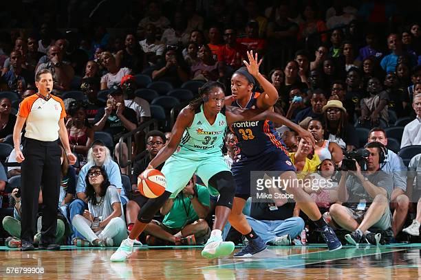 Tina Charles of the New York Liberty posts up against Morgan Tuck of the Connecticut Sun on July 17 2016 at Madison Square Garden in New York City...