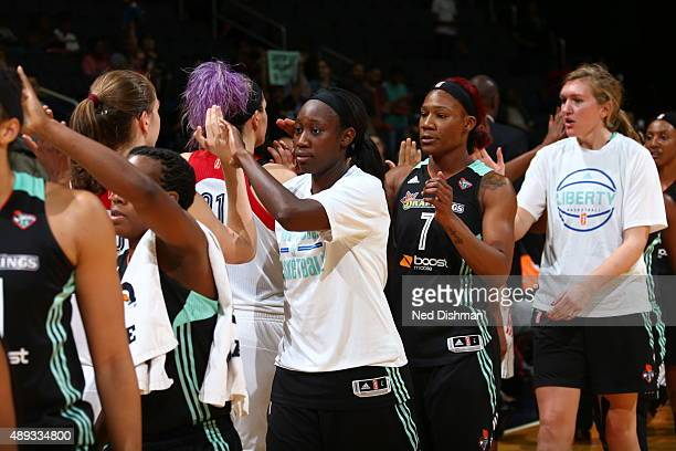 Tina Charles of the New York Liberty shakes hands with the Mystics after defeating the Washington Mystics in Game Two of the WNBA Western Conference...