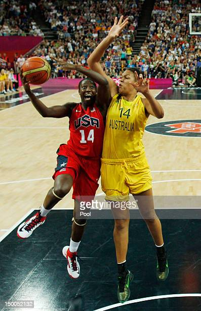 Tina Charles of the US is guarded by Australia's Liz Cambage during the London 2012 Olympic Games women's semifinal basketball game bewteen Australia...