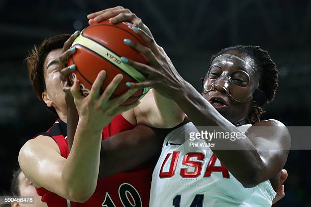 Tina Charles of United States battles for the ball with Ramu Tokashiki of Japan during the Women's Quarterfinal match on Day 11 of the Rio 2016...