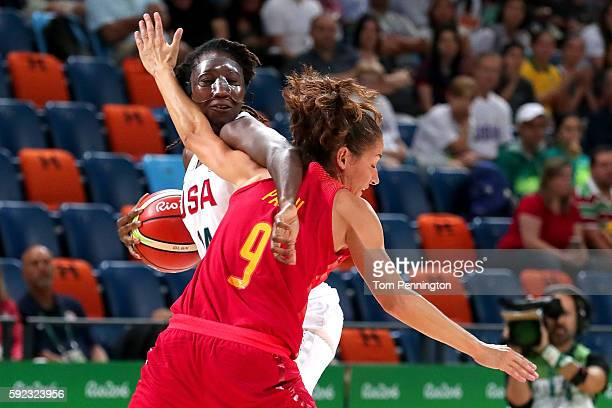 Tina Charles of United States handles the ball against Laia Palau of Spain during the Women's Gold Medal Game between United States and Spain on Day...