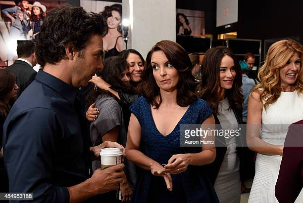 Tina Fey and Abigail Spencer attends the Guess Portrait Studio during 2014 Toronto International Film Festival on September 8 2014 in Toronto Canada