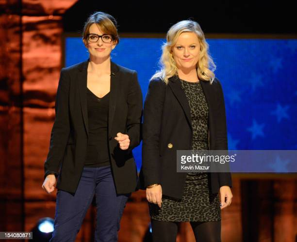 Tina Fey and Amy Poehler speak on stage at Comedy Central's Night of Too Many Stars America Comes Together for Autism Programs at The Beacon Theatre...