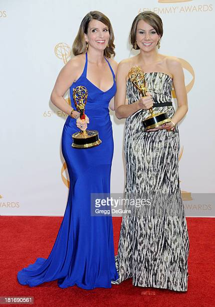 Tina Fey and Tracey Wigfield pose in the press room at the 65th Annual Primetime Emmy Awards at Nokia Theatre LA Live on September 22 2013 in Los...