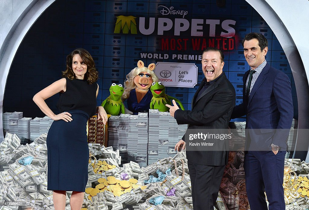 Tina Fey, Constantine, Miss Piggy, Kermit, Ricky Gervais and Ty Burrell arrive for the premiere of Disney's 'Muppets Most Wanted' at the El Capitan Theatre on March 11, 2014 in Hollywood, California.