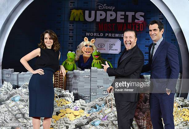"""Tina Fey, Constantine, Miss Piggy, Kermit, Ricky Gervais and Ty Burrell arrive for the premiere of Disney's """"Muppets Most Wanted"""" at the El Capitan..."""