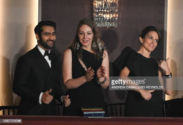 Tina Fey Kumail Nanjiani and his wife writer Emily V Gordon do the 'Elaine Dance' during the show for the 21st Annual Mark Twain Prize for American...