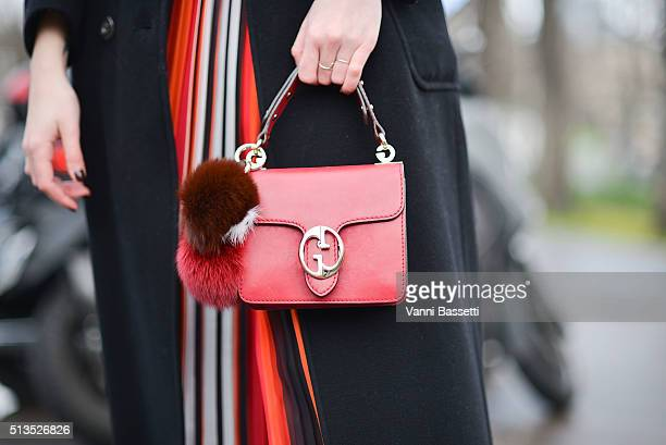 Tina Gallo poses wearing an Hanita dress and a Gucci bag before the Chloe show at the Grand Palais during Paris Fashion Week FW 16/17 on March 3 2016...