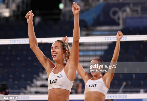 Tina Graudina and Anastasija Kravcenoka of Team Latvia react after defeating Team Canada during the Women's Quarterfinal beach volleyball on day...