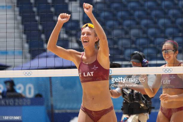 Tina Graudina of Team Latvia celebrates after defeating Team Brazil during the Women's Preliminary Round - Pool D beach volleyball on day five of the...