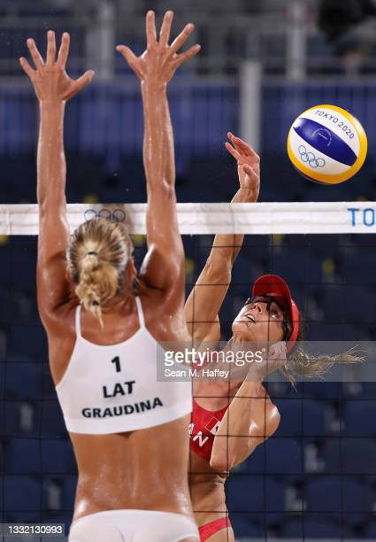 Tina Graudina of Team Latvia competes against Heather Bansley of Team Canada during the Women's Quarterfinal beach volleyball on day eleven of the...