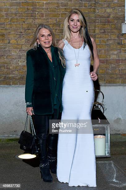 Tina Green and Stasha Lewis attends the private view of Stasha Palos: And The Stars Shine Down at Saatchi Gallery on December 2, 2014 in London,...