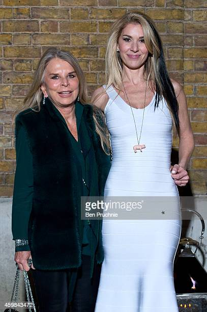 Tina Green and Stasha Lewis attends the private view of Stasha Palos' 'And The Stars Shine Down' at Saatchi Gallery on December 2, 2014 in London,...