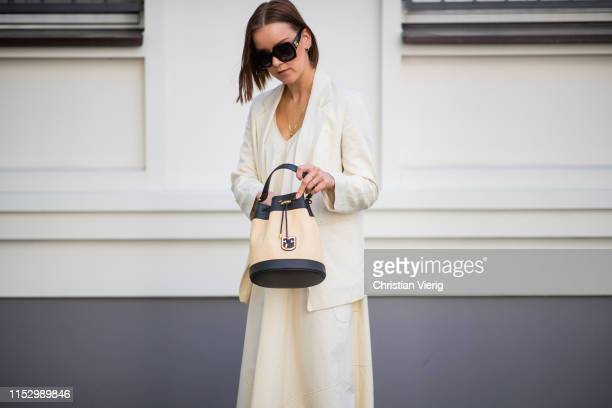 Tina Haase is seen wearing creme white Drykorn blazer and dress Furla bag Celine necklace Gucci sunglasses on May 31 2019 in Berlin Germany