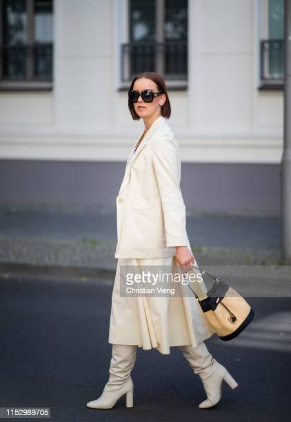 Tina Haase is seen wearing creme white Drykorn blazer and dress Zara boots Furla bag Celine necklace Gucci sunglasses on May 31 2019 in Berlin Germany