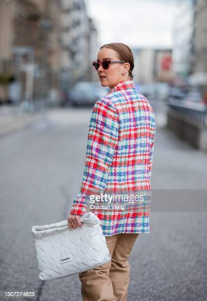 Tina Haase is seen wearing Essentiel Antwerp Tweed blazer, Uterque leather pants in beige, Maison Margiela Tabi boots, Prada sunglasses, Karl...