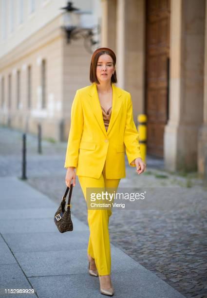 Tina Haase is seen wearing Fendi bag yellow Drykorn suit Tamaris pumps on May 31 2019 in Berlin Germany
