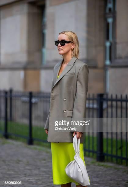 Tina Haase is seen wearing Joseph Blazer in grey, Iris & Ink dress in yellow, Nanushka bag in white, Zara heels in green, Chanel sunglasses on July...