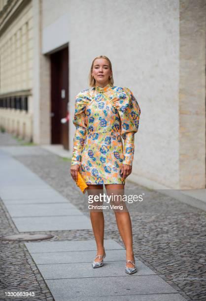 Tina Haase is seen wearing Rotate Birger Christensen dress with print, silver Scarosso heels, Fendi micro bag in orange on July 25, 2021 in Berlin,...