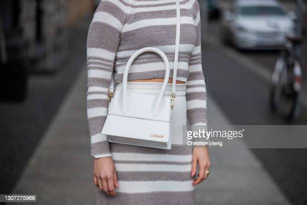 Tina Haase is seen wearing striped Bally top and skirt, Jacquemus bag in white, Zara heels on March 15, 2021 in Berlin, Germany.