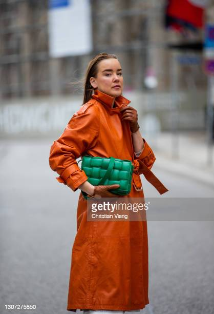 Tina Haase is seen wearing trench coat Selected, Bally boots and gloves in brown, green Bottega Veneta bag on March 15, 2021 in Berlin, Germany.