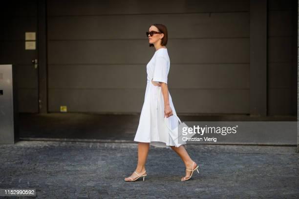Tina Haase is seen wearing white see by Chloe dress Jacquemus bag Zara heels Celine sunglasses on May 31 2019 in Berlin Germany