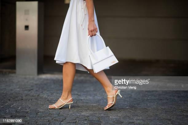 Tina Haase is seen wearing white see by Chloe dress Jacquemus bag Zara heels on May 31 2019 in Berlin Germany