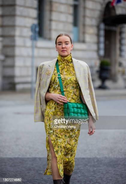 Tina Haase is seen wearing yellow Baum & Pferdgarten dress with floral print and checkered blazer, green Bottega Veneta bag, Loewe brooch, green...