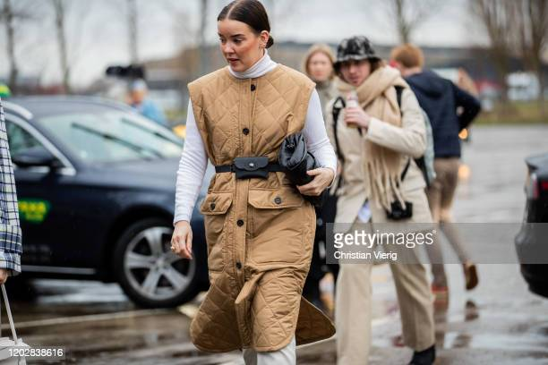 Tina Haase seen wearing beige sleeveless belted coat black bag white turtleneck outside Holzweiler during Copenhagen Fashion Week Autumn/Winter 2020...