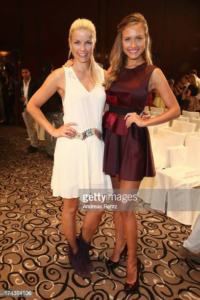 Tina Kaiser and Alena Gerber attend the Marcel Ostertag fashion show at Charles Hotel on July 24 2013 in Munich Germany