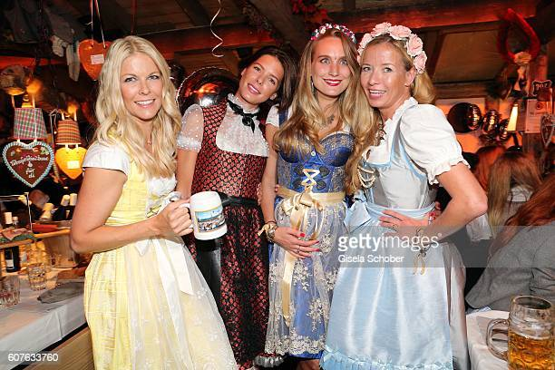 Tina Kaiser Julia Trainer Verena Ofarim and Georgia Guillaume during the 'Almauftrieb' as part of the Oktoberfest 2016 at Kaeferschaenke beer tent on...