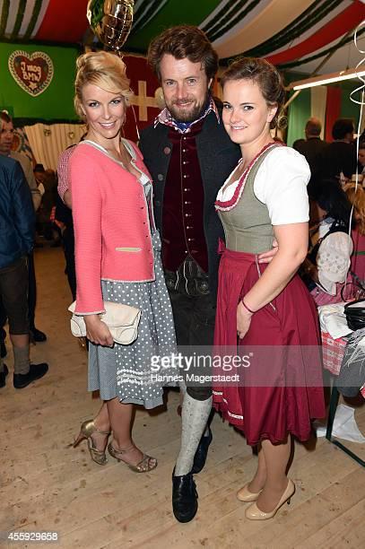 Tina Kaiser Michael von Hassel and his sister Theresa von Hassel the BMW Armbrustschiessen at ArmbrustSchuetzenfesthalle during Oktoberfest at...