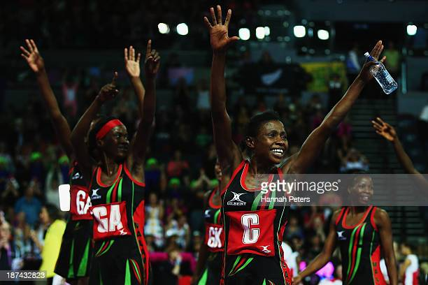 Tina Kamzati and Caroline Mtukule of Malawi thank the crowd after winning the match between Malawai and England on day two of the Fast5 Netball World...