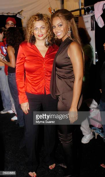 Tina Knowles and her daughter singer/actress Beyonce Knowles pose backstage at the BCBG Max Azria Spring/Summer 2004 fashion show at Bryant Park...