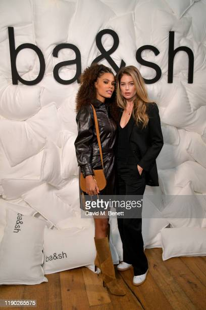 Tina Kunakey and Doutzen Kroes attend the bash x Doutzen Kroes launch of The Teddy Bag on November 26 2019 in London England