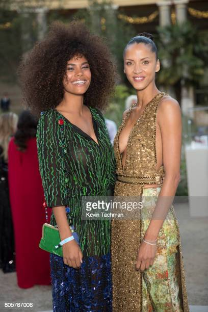 Tina Kunakey and Noemie Lenoir arrive for the amfAR Paris Dinner at Le Petit Palais on July 2 2017 in Paris France