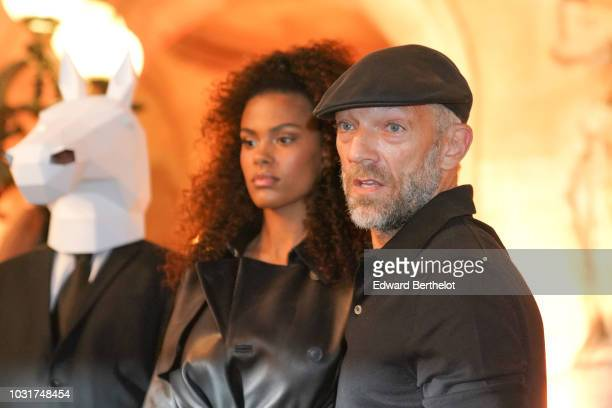 Tina Kunakey and Vincent Cassel are seen outside the Longchamp 70th Anniversary Celebration at Opera Garnier on September 11 2018 in Paris France