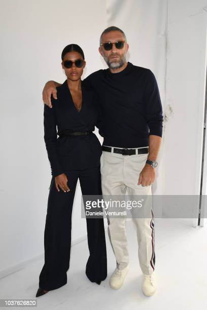 Tina Kunakey and Vincent Cassel attend the Roberto Cavalli show during Milan Fashion Week Spring/Summer 2019 on September 22 2018 in Milan Italy