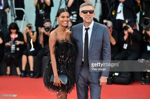Tina Kunakey and Vincent Cassel walk the red carpet ahead of the J'Accuse screening during the 76th Venice Film Festival at Sala Grande on August 30...