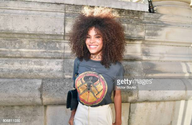 Tina Kunakey attends 'Christian Dior couturier du reve' Exhibition Launch celebrating 70 years of creation at Loulou Club on July 3 2017 in Paris...