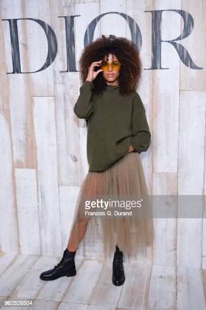 Tina Kunakey attends the Christian Dior Couture S/S19 Cruise Collection Photocall At Grandes Ecuries De Chantillyon May 25 2018 in Chantilly France