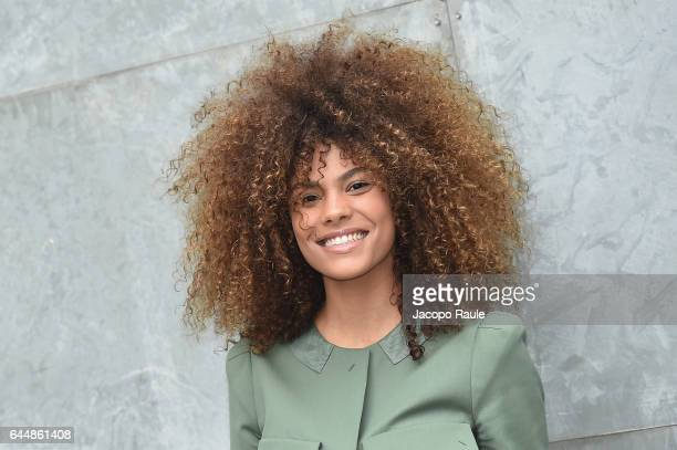Tina Kunakey attends the Emporio Armani show during Milan Fashion Week Fall/Winter 2017/18 on February 24 2017 in Milan Italy