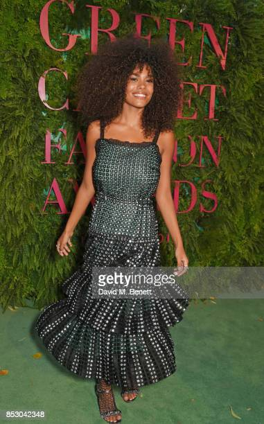Tina Kunakey attends the Green Carpet Fashion Awards Italia wearing Marco De Vincenzo for the Green Carpet Challenge at Teatro Alla Scala on...