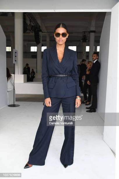 Tina Kunakey attends the Roberto Cavalli show during Milan Fashion Week Spring/Summer 2019 on September 22 2018 in Milan Italy