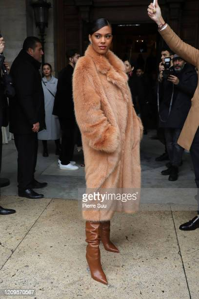 Tina Kunakey attends the Stella McCartney show as part of the Paris Fashion Week Womenswear Fall/Winter 2020/2021 on March 02 2020 in Paris France