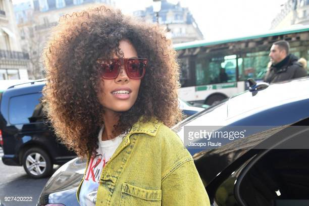 Tina Kunakey attends the Stella McCartney show as part of the Paris Fashion Week Womenswear Fall/Winter 2018/2019 on March 5 2018 in Paris France