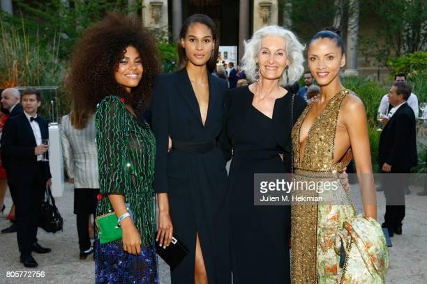 Tina Kunakey Cindy Bruna Catherine Loewe Noemie Lenoir attends the amfAR Paris Dinner 2017 at Le Petit Palais on July 2 2017 in Paris France