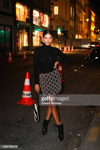 Tina Kunakey is seen outside the Fendi cocktail #Fendimania on October 16 2018 in Paris France