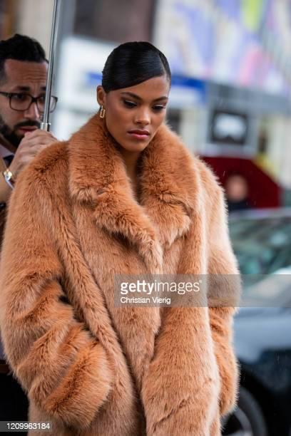 Tina Kunakey is seen wearing rust brown faux fur coat outside Stella McCartney during Paris Fashion Week Womenswear Fall/Winter 2020/2021 Day Eight...